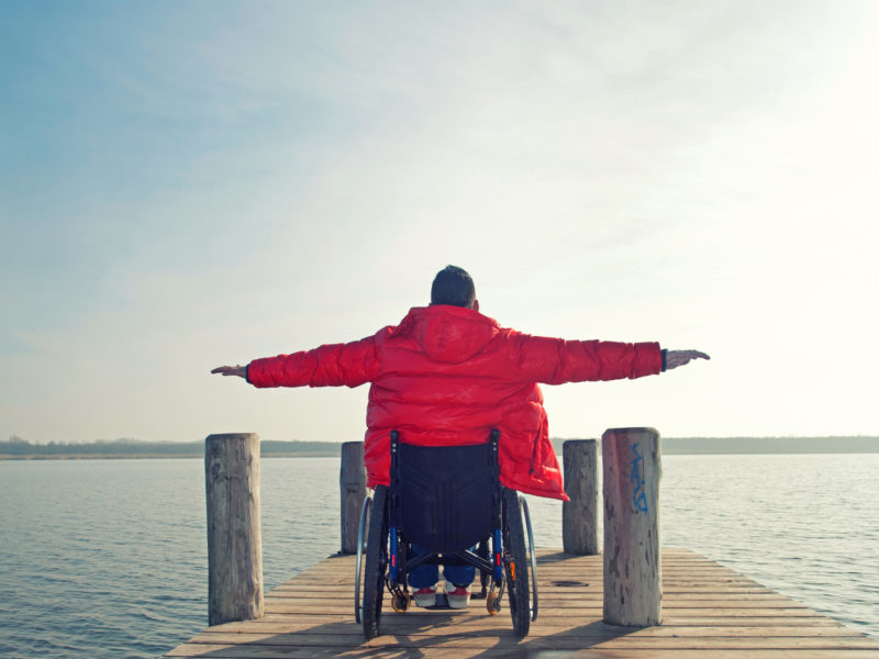 Young,Man,In,Wheelchair,With,Wide,Opened,Arms,Enjoying,His